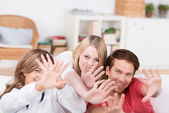 Laughing teenagers holding out their hands — Stock Photo