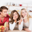 Three young friends undecided on what to cook — Stock Photo #35837489