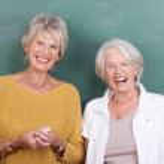 Two laughing elderly women — Stock Photo