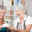 Laughing senior ladies celebrate a birthday — Stock Photo #37247983