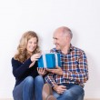 Husband giving his wife a gift — Stock Photo #37248463