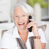 Senior woman chatting on her mobile — Stock Photo