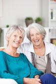 Two happy laughing senior women — Stock Photo