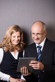 Businessman showing his partner a tablet-pc — Stock Photo