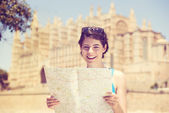 Woman sightseeing with a map — Stock Photo