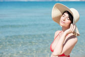 Young woman on beach enjoying the sun — Stock Photo
