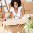 Beautiful woman packing to move house — Stock Photo