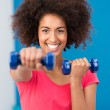 Happy healthy young woman working out in a gym — Stock Photo #38561819