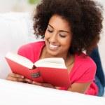 Beautiful African American woman reading — Stock Photo #38562337
