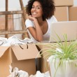 Woman unpacking boxes in her new home — Stock Photo