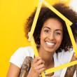 Excited African American woman in her new home — Stock Photo