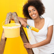 African American woman doing home renovations — Stock Photo