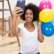 Happy African American woman taking a selfie — Stock Photo