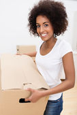 African American woman moving house — Stock Photo