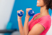 Woman working out with dumbbells — Stock Photo