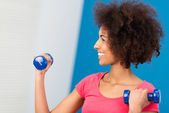 Happy beautiful woman exercising in the gym — ストック写真
