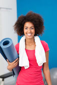 Sporty African American woman arriving at the gym — Stock Photo