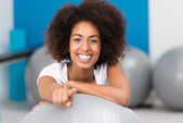 Beautiful young African American lady in a gym — Stock Photo