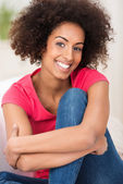 Smiling woman with an Afro hairstyle — Stock Photo