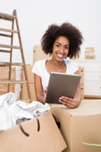 Woman renovating her home using a tablet-pc — Stock Photo