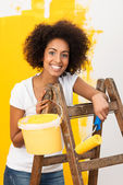 African American woman doing redecorating — Stock Photo