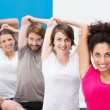 Friends doing aerobics together at the gym — Stock Photo #38613625
