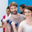Stock Photo: Young couple working out at gym