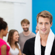 Smiling handsome young man at the gym — Stock Photo #38619683