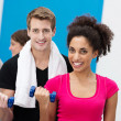 Multiethnic couple working out with dumbbells — Stock Photo #38619693