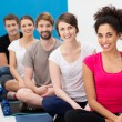 Group of young friends practising yoga — Stock Photo #38619739