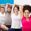 Group of fit young friends exercising at the gym — Stock Photo #38619749