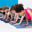 Group of athletic young people in a gym — Stock Photo #38619761