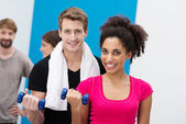 Multiethnic couple working out with dumbbells — Stock Photo