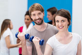 Young couple working out at the gym — Stock Photo