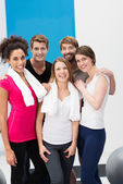 Group of sporty young people at the gym — Stock Photo