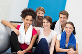 Happy group of young friends at the gym — Stock Photo