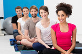 Group of young friends practising yoga — Stock Photo