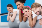 Smiling group of friends practising Pilates — Stock Photo