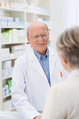 Sympathetic friendly male pharmacist — Stock Photo