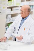 Pharmacist entering prescription details — Stock Photo