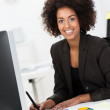 African American businesswoman at her desk — Stock Photo #39311069
