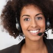 African American businesswoman in a headset — Stock Photo