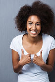 Young African American woman showing thumbs up — Stock Photo