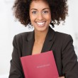 African American woman clutching a red file — Stock Photo #39376135