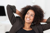 Smiling businesswoman smiling as she relaxes — Stock Photo