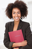 African American woman clutching a red file — Stock Photo