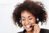 Friendly African American call centre operator — Stock Photo