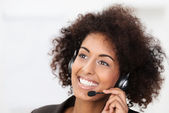 Beautiful vivacious client services operator — Stock Photo