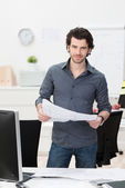 Businessman dealing with paperwork — Stock Photo