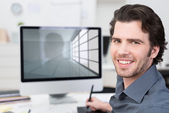 Businessman working with his computer — Stock Photo